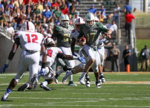 Baylor Bears quarterback Seth Russell (17) scrambles out of the pocket against the SMU Mustangs during the third quarter at McLane Stadium in Waco, Texas.