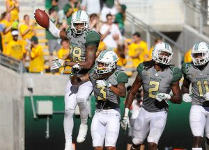 Baylor Bears safety Orion Stewart (28) celebrates a pick six with his teammates during the second half against the SMU Mustangs at McLane Stadium in Waco, Texas.