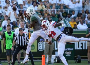 Baylor Bears wide receiver KD Cannon (9) catches a touchdown pass over SMU Mustangs defensive back Christian Davis (28) during the second half at McLane Stadium in Waco, Texas.