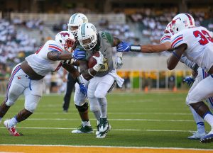 Baylor Bears running back JaMycal Hasty (6) breaks through attempted arm tackles by SMU Mustangs defenders for a touchdown at McLane Stadium in Waco, Texas.