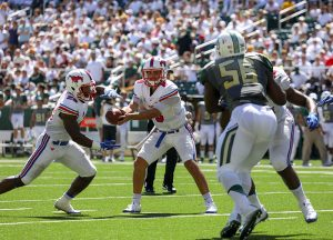 SMU Mustangs quarterback Ben Hicks (8) hands off to SMU Mustangs running back Ke'Mon Freeman (29) during the first quarter against the Baylor Bears at McLane Stadium in Waco, Texas. In his first career start, the redshirt freshman threw for 229 yards on 17 completions, 1 touchdown and 3 interceptions.