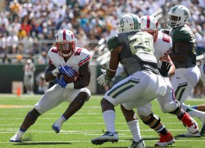 SMU Mustangs running back Ke'Mon Freeman (29) rushes through the line of scrimmage against the Baylor Bears at McLane Stadium in Waco, Texas.