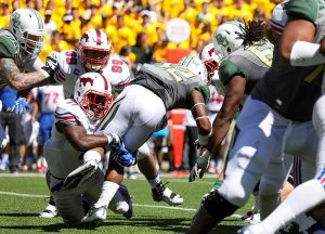 SMU Mustangs linebacker Kyran Mitchell (11) wraps up Baylor Bears running back Shock Linwood (32) behind the line of scrimmage during the second quarter at McLane Stadium in Waco, Texas. Mitchell, a true freshman, recorded 8 solo tackles in the game.