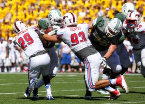 SMU Mustangs defensive back Darrion Millines (29) and defensive end Mason Gentry (93) wrap up a Baylor Bears ball carrier behind the line of scrimmage at McLane Stadium in Waco, Texas. Millines led the team in tackles with 10.