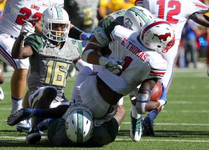 SMU Mustangs wide receiver Kevin Thomas (1) is tackled by two Baylor Bears defenders in the third quarter at McLane Stadium in Waco, Texas.