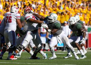 SMU Mustangs offensive lineman Chauncey Briggs (71) is stiff armed by a Baylor Bears defensive lineman during the second half at McLane Stadium in Waco, Texas.